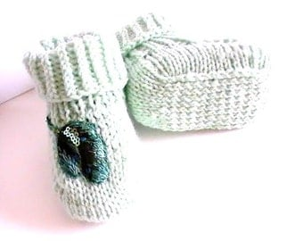 Opaline green acrylic baby shoes