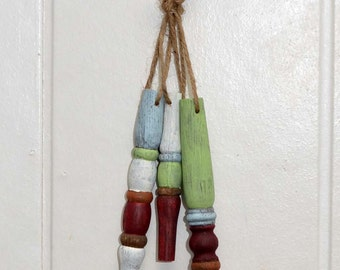 Set of 3 handpainted ornaments made from reclaimed spindles