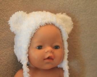 Handmade crochet fuzzy bear baby bonnet on white