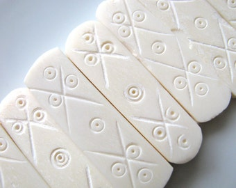 Carved bone rectangles, 6 holes in each piece, 38 by 10mm. 8 beads - #142