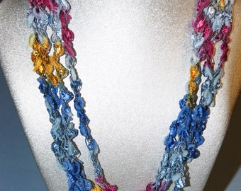 Spring colors, beautiful, lightweight crocheted necklace.  Adjustable length