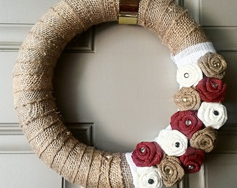 Burlap wreath with burgundy, brown, and white flowers