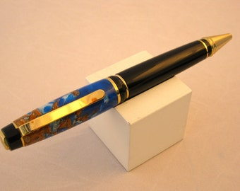 Handmade blue, white and red handmade pine cone pen by Specialty Turned Designs