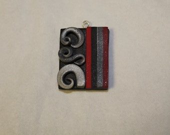 Black, Red, and Silver Swirl Polymer Clay Pendant