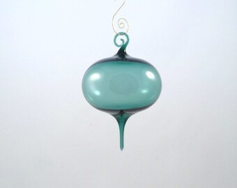 Large transparent teal ornament