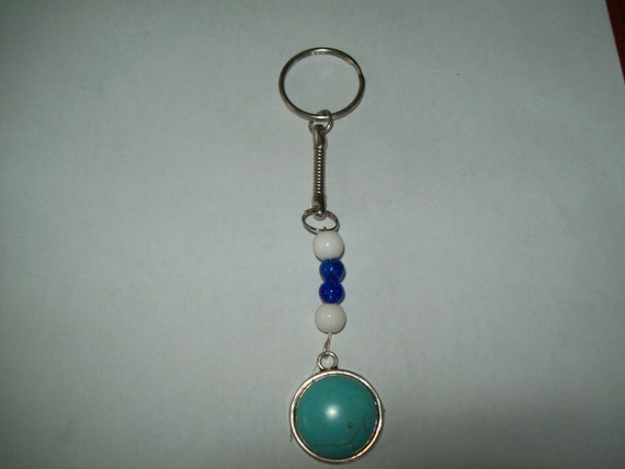 white dark blue keyring light blue pendant