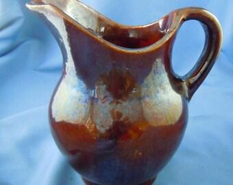 Brown slip glaze American pitcher