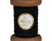 Black Sparkle Ribbon on Wooden Spool