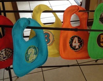 Monthly bibs for your baby to designate the month of birth.