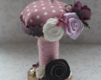 Plum cotton spool pincushion