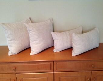 Cream textured cushion