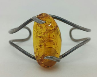 Wire design Sterling Cuff  Bracelet with a large Amber Stone