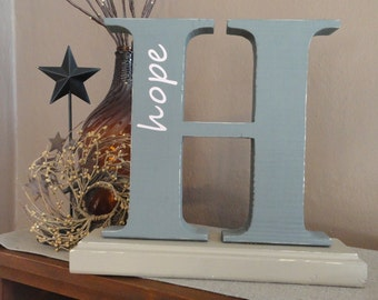 Wooden letter H with 'hope' monogram