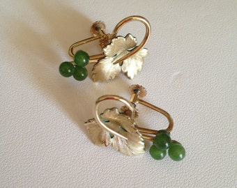 Vintage 1950's Krementz gold tone and genuine green jade earrings.