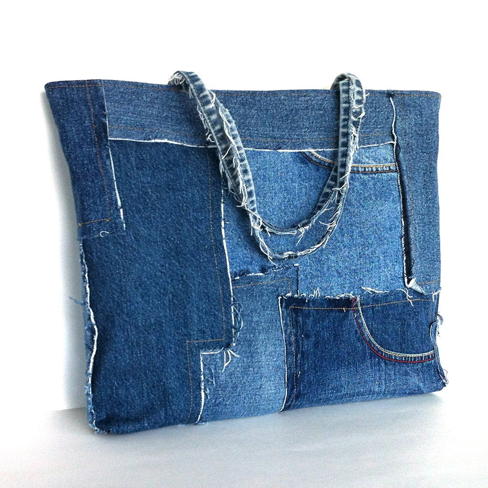 Denim is in beautiful condition. -key fob attached to inside of bag. -top of bag closes with one very strong magnetic snap. -four small pocket on inner walls of bag—includes .
