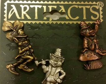 Vintage oldstock J&J artifacts clutch lapel pins set of three leprechauns silvertone goldtone and brasstone