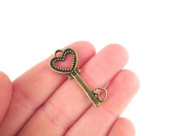 10 brass heart skeleton key charms 32x14mm
