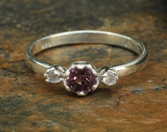 Amethyst ring with side set moonstone gems in silver band