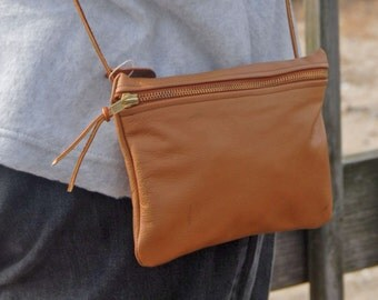 L6. Light Tan Leather Side Pouch with Zipper Closure