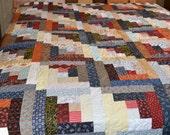 Queen sized scrappy log cabin quilt