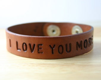 Personalized leather bracelet custom stamped with I Love You More. Customize with your favorite phrase, verse, name, or quote.