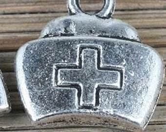 nurse hat cap  charm pendant red cross  silver color jewelry findings supplies quantity four   CCB19 face parts