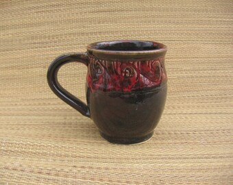 Wheel thrown and carved red and black mug
