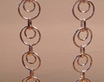 Silver hoop dangle earrings