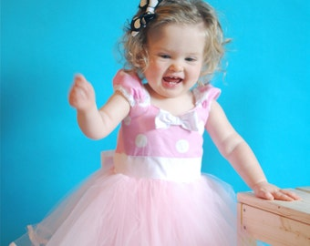 baby Minnie Mouse dress in  light pink polka dot  with white trimmings