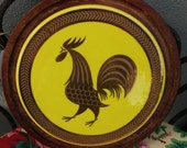 ROOSTER ROUND yellow trivet, tray, dish, metal on wood