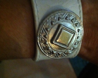 White leather cuff  with silver medallion handmade