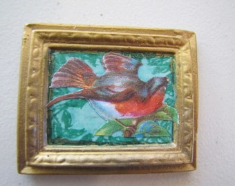 Dollhouse miniature picture decoupage of bird landing on a branch