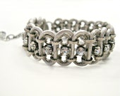 Handmade crystal, chain, leather woven bracelet. Metallic ivory/pearl, antique silver, sweet, romantic, bling, adjustable.