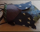 """Cicada purse, a small bag made from recycled vintage ties. It is in blues, greens and purple with a cross body strap it is 7""""by 4"""""""