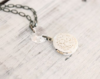 Tiny Ivory cream floral pattern locket necklace with chandelier style crystal connector.  Small dainty vintage style.