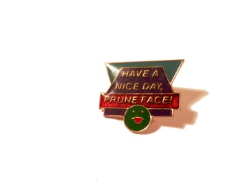 Rude Hat Pin Have a Nice Day Prune Face 1980s enamel lapel pin