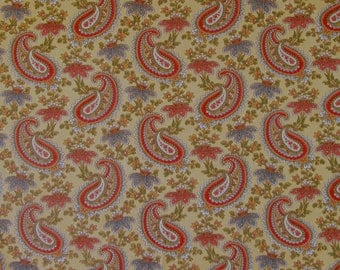 A  lightweight 100% cotton decorator sample with multi-colored paisleys and flowers on a light gold ground