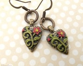 Heart shaped earrings with hand painted flowers and leaves