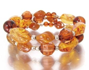Vintage AMBER LUCITE WRAP bracelet Carved Molded Beads Spangles Silver Tone