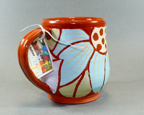 Handmade pottery mug floral design carved on terracotta for Handmade mug designs