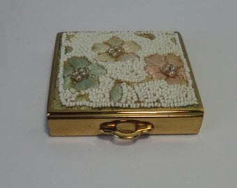 Compact in Gold tone metal with Embroidered Flowers and Beaded lid. Made in U.S.A