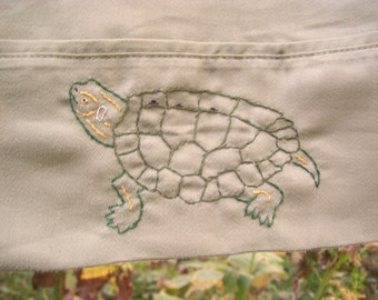 False Map Turtle pillowcase- hand embroidered