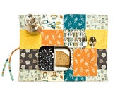Baby geek placemat with rockets and robots. Organic lunchbox set in blue, orange, yellow and brown.