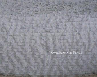 Grey  ruffled knit..cascaing ruffle fabric..1 inch ruffles