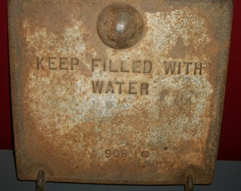 """Vintage Iron Door Reads """"Keep Filled with Water"""""""