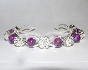 Beautiful silver plated bracelet with purple Picasso glass beads