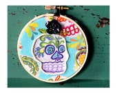 Girl with Blue Flower: Funky Embellished Day of the Dead Halloween 3-Inch Skull Hoop Art with Blue Flower, Beads, Sequins