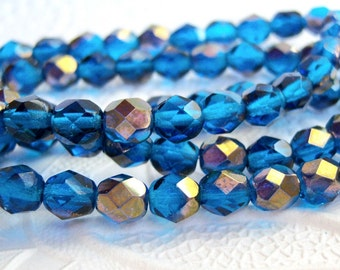 Czech 6mm faceted round capri blue beads with a luster bronze finish, lot of (30) - DV74