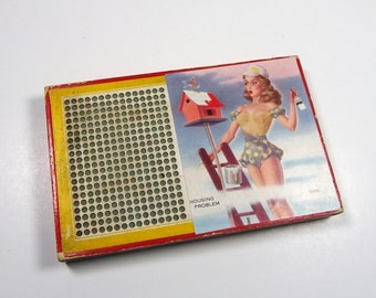 "PINUP PUNCH BOARD, Small, Unused,  Layne, ""Housing Problem, Harlich Co., Vintage Girlie Art"