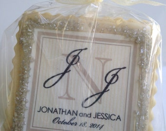 custom cookie favors champagne and black monogram